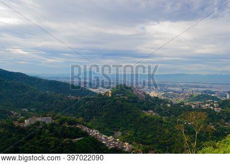 Aerial View Of The Favelas And The City Of Rio De Janeiro
