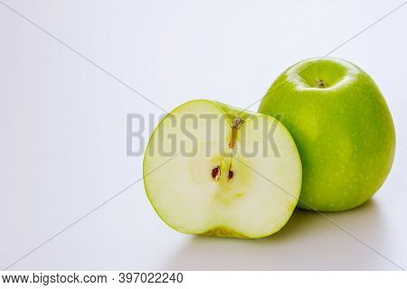 Green Cut Apple And Isolated On White Background. Produce Product.