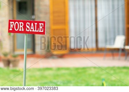 Home For Sale With Real State Sign In Spring Or Summer Season