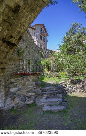 A Mountain Village House Built In Stone And A Garden Decorated With Flowers, On A Summer Day, Sallen
