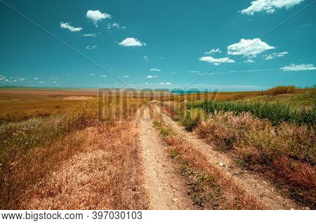 Dirt Road In The Steppe Near The Sea On A Sunny Day