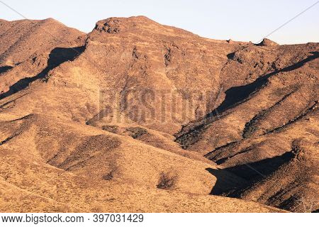 Arid Golden Fields On Barren Hills With Grasslands During Sunset Taken In The Rural Southern Califor