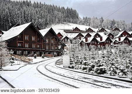 Wooden Cottages Holiday House In Mountain Holiday Resort Covered With Fresh Snow In Winter. Winter S
