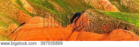 Big Bogdo Mountain. Red Sandstone Layers Outcrops On The Slopes Sacred Mountain In Caspian Steppe Bo