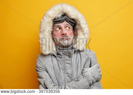 Arctic Challenge. Frozen Man Trembles During Extreme Freeze During Winter Looks Above Wears Warm Jac
