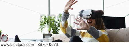 Girl Having Fun At Home With Virtual Glasses. Reality Is Transmitted To Man Through His Sensations S