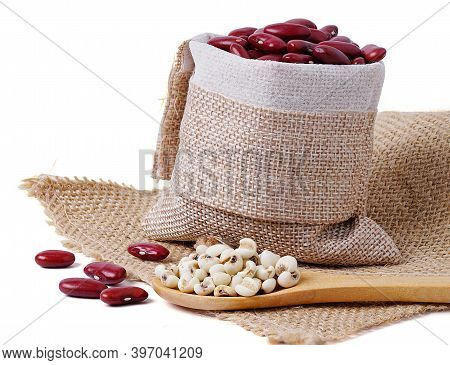 Isolated Seed Grains. Wooden Spoon With Porridge, Cereals, Lentils, Peas And Beans Isolated On White