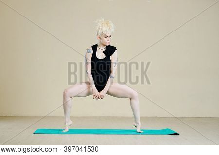 Attractive Stylish Female Dance With Strong Beautiful Legs Doing Plie Squat