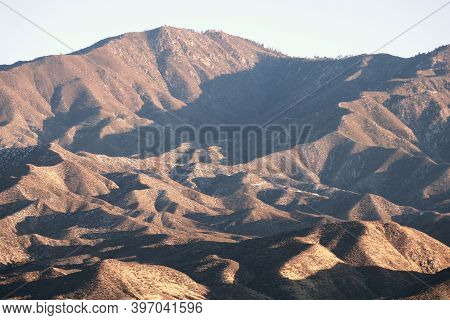 Sun Setting On Arid Mountains Creating Natural Shadows Taken At The Arid Desert In The Rugged San Ga