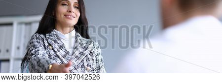 Beautiful Office Woman Holds Out Her Hand To Man. Well-developed Intuition In Workplace. Self-esteem
