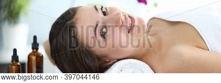 Happy Girl Is Lying In Massage Room And Smiling. Improve Health And Well-being. Muscle Tension After
