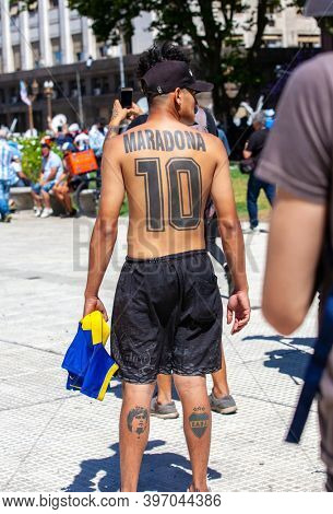 Buenos Aires, Argentina - 26 November, 2020: Tattoos on the back of a fan of Diego Maraudona who came to say goodbye to the idol