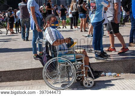 Buenos Aires, Argentina - 26 November, 2020: disabled person in a wheelchair on the day of farewell to Diego Maradona in Buenos Aires