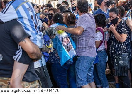 Buenos Aires, Argentina - 26 November, 2020: People on the day of farewell to Diego Maradona near the Presidential Palace in Buenos Aires