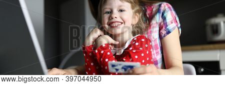 Mom And Daughter Kitchen Enter Credit Card Details. Mandatory Payment Forecast. Calculate The Amount