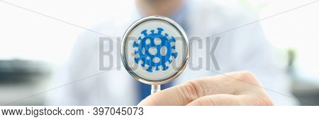 Doctor Holds Stethoscope Infected With Coronavirus. Fast-growing Healthcare Segment. Reduce Number T