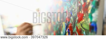 Man Paints Large Bright Abstract Painting Picture. Hands Hold Brush With Multi-colored Paint. Learni