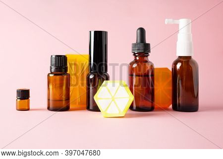 Essential Oils, Various Bottles Aromatherapy On A Pink Background. Aromatherapy And Perfumes Concept