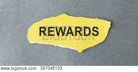 Rewards, Note With Pen On Yellow Background