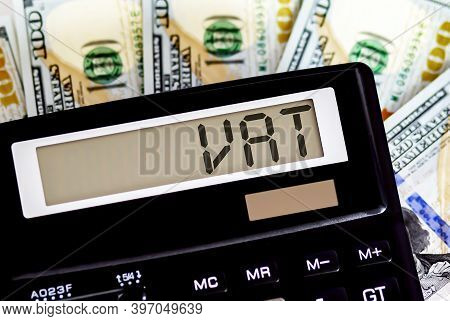 Calculator With Text Vat On Dollars. Business, Finance Conceptual.