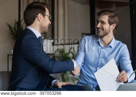 Client Satisfied Of Getting Loan Insuring Life Handshaking With Banker