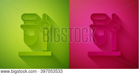 Paper Cut Glass Test Tube Flask On Stand Icon Isolated On Green And Pink Background. Laboratory Equi