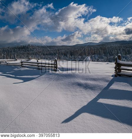 Picturesque Shadows On Snow From Wood Fence. Alpine Mountain Winter Hamlet Outskirts, Snowy Path, Fi