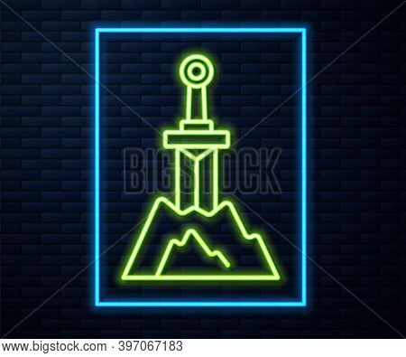 Glowing Neon Line Sword In The Stone Icon Isolated On Brick Wall Background. Excalibur The Sword In