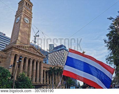 Brisbane, Australia - November 29, 2020: Protestor Holds Thailand National Flag In The Peacefully Ra