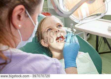 Child To The Dentist. Child In The Dental Chair Dental Treatment During Surgery. Small Kid Patient V