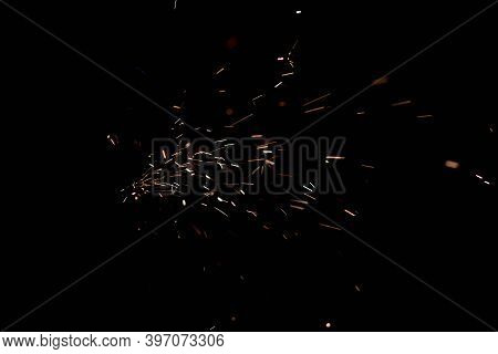 Glowing Flow Of Sparks In The Dark. Fire Sparks On A Dark Background