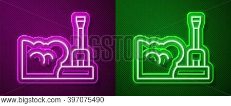 Glowing Neon Line Shovel In Snowdrift Icon Isolated On Purple And Green Background. Vector