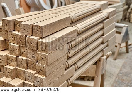 Turning Wooden Stair Balusters. Wood Stair Balusters Stacked In Workshop