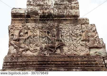 Bas-relief Sculpture With Dancing Apsara On The Tower Of Prasat Bayon Temple, Angkor Thom, Cambodia