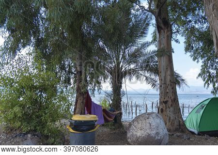 View Of Sea Of Galilee Against The Background Of The Golan Heights In Israel. Camping On The Shores