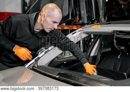 Close Up, Car Glazing, Fixing And Repairing A Windshield. Windscreen Replace Process Of A Car At A G