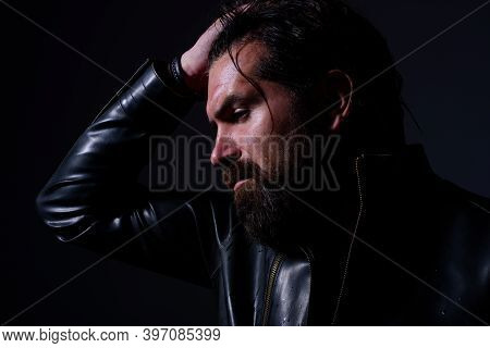 Brutal Bearded Man In Leather Jacket. Silhouette Of Handsome Man. Barber Shop. Fashion. Bearded Man