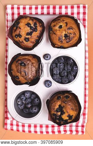 Homemade Blueberry Muffins With Berries Baking Dish Napkin Ligh Brown Background Top View Vertical