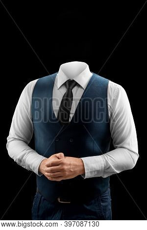 Businessman In A White Shirt, Vest And Headless Tie On A Dark Background. Isolate.