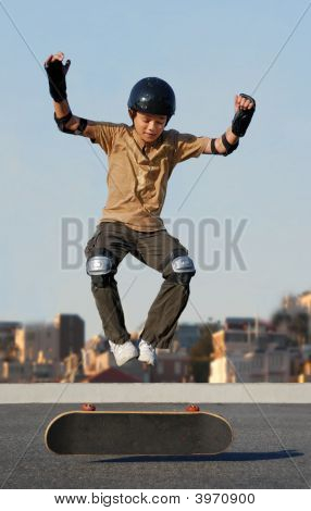 Boy Jumping From Skateboard