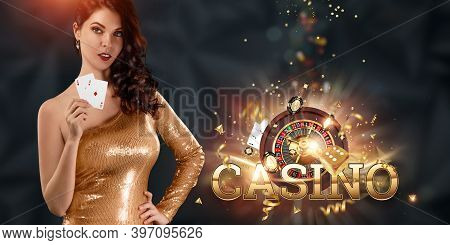 A Beautiful Young Girl In A Gold Dress Holds Playing Cards In Her Hands On A Dark Background, Casino