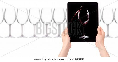 Glass Of Red Wine On Tablet Computer Screen