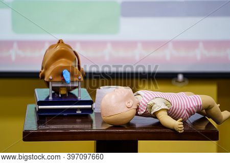 Infant Dummy First Aid Demonstration Series. First Aid Instructor Demonstrating Artificial Respirati