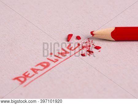 Deadline Lettering. Deadline Word. Deadline Lettering Written On Paper In Red Pencil.
