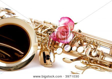 Pink Rose On Gold Saxophone Isolated On White