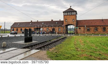 Auschwitz, Poland - July 30th 2018: The Railway And Entrance At The Auscwitz Gatehouse At The Auschw