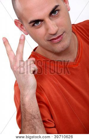 Man holding up two fingers
