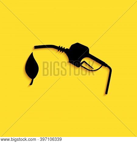Black Bio Fuel Concept With Fueling Nozzle And Leaf Icon Isolated On Yellow Background. Natural Ener
