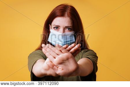 Young Woman Wearing Medical Face Mask Making Stop Gesture With Her Hands - Resistance Against Corona