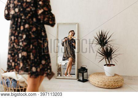 Beaubeautiful Brunette Woman Tries Dressing Room Wardrobetiful Brunette Woman Tries Dressing Room Wa